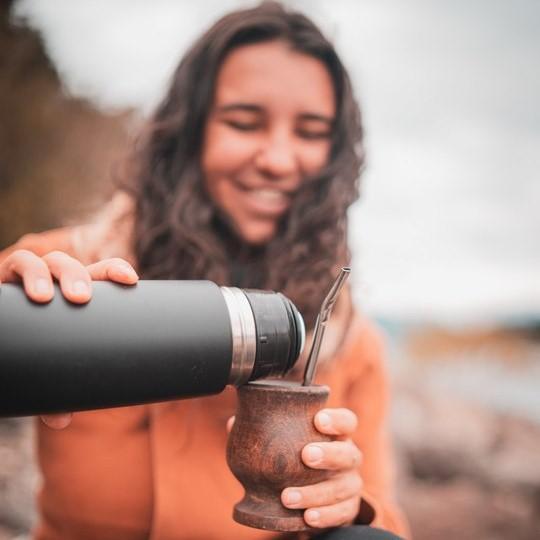 A girl serving a mate gourd